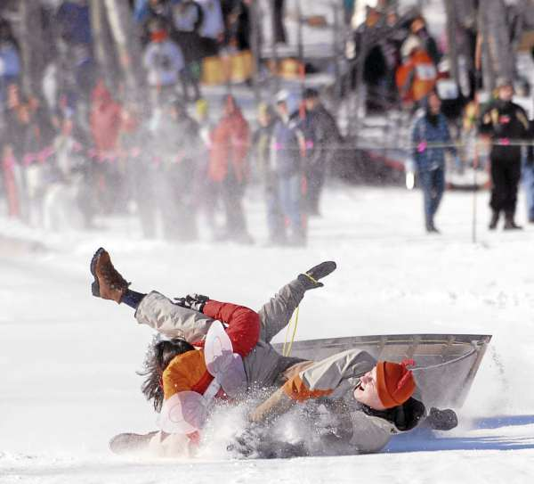 Two-person team 'Wild Thing' Lives up to their name as they arrive at the bottom of the US Toboggan Championships' chute in Camden in 2007.