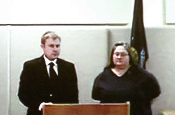 Jodi Lynn Holmes (right) with her attorney Aaron Frye is arraigned on the Class B felony charge of aggravated assault during her video conferencing appearance before Bangor District Court on Wednesday, Feb. 9, 2011. Holmes allegedly tried to suffocate an elderly woman with a pillow on Sunday, Feb. 6, at the Bangor Nursing and Rehabilitation Center. Bail was set at $50,000 cash.