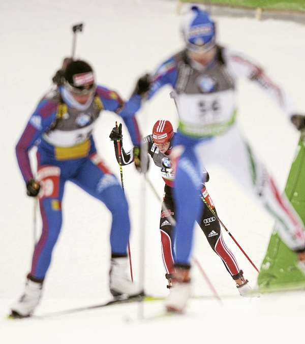 Competitors chage up a hill during the Biathlon World Cup women's 7.5K sprint race at the 10th Mountain Ski Center in Fort Kent Friday.