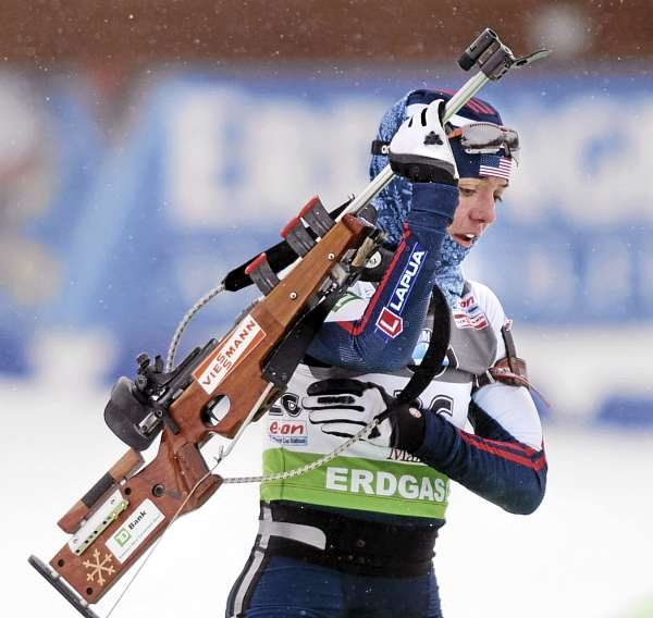 The USA's Sara Studebaker gets ready in the shooting range during the Biathlon World Cup women's 7.5K sprint race at the 10th Mountain Ski Center in Fort Kent Friday.  Studebaker was the fastest American, as she finished in 17th place with a time of 24 minutes 46.4 seconds.