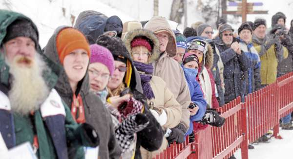 People watch the Biathlon World Cup women's 7.5K sprint race at the 10th Mountain Ski Center in Fort Kent Friday.  About 800 people came to the event braving the cold and the wind and cold.