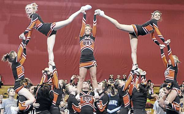 Members of the Brewer High School cheering squad perform their routine in the Maine High School Class A Cheerleading Competition at the Bangor Auditorium Saturday afternoon, Feb. 12, 2011. The Lewiston Blue Devils took first place.