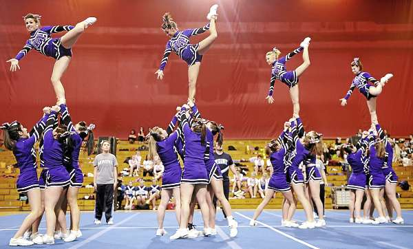Members of the Hampden Academy cheering squad perform their routine in the Maine High School Class A Cheerleading Competition at the Bangor Auditorium Saturday afternoon, Feb. 12, 2011. The Lewiston Blue Devils took first place.