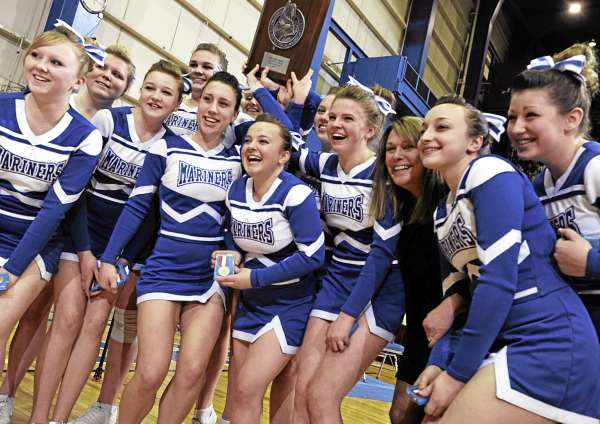 Members of the Deer Isle-Stonington cheering squad pose for a group shot after taking second place in the in the Maine High School Class D Cheerleading Competition at the Bangor Auditorium Saturday afternoon, Feb. 12, 2011.