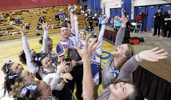 Members of the Central Aroostook High School cheering squad and their coaches share the joy after they took first place in the  Maine High School Class D Cheerleading Compettion at the Bangor Auditorium Saturday afternoon, Feb. 12, 2011.