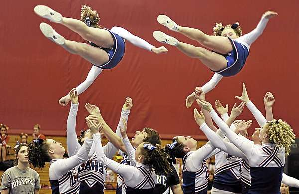 Two members of the of the Central Aroostook High School cheering squad are spun into the air by their teammates during their  their routine in the Maine High School Cheerleading Competition at the Bangor Auditorium Saturday afternoon, Feb. 12, 2011. The Central Arrostook Panthers took first place.