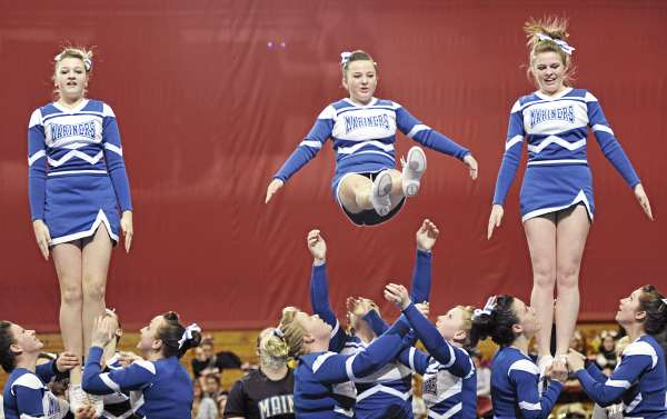 Members of the Deer Isle-Stonington cheering squad perform their routine in the Maine High School Class D Cheerleading Competition at the Bangor Auditorium Saturday afternoon, Feb. 12, 2011.