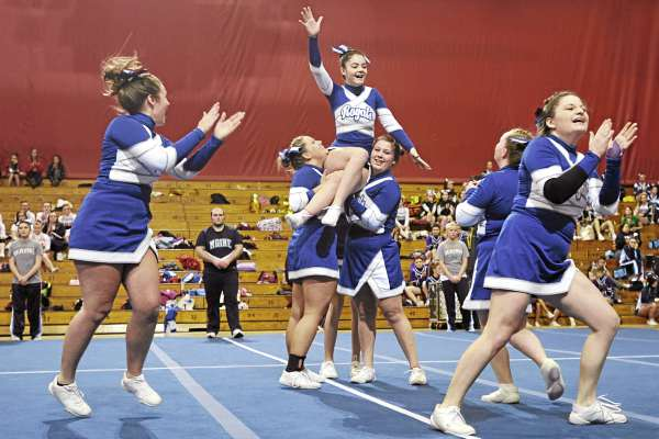 Members of the Jonesport-Beals High School cheering squad react to applause immediately following their routine in the Maine High School Cheerleading Competition at the Bangor Auditorium Saturday afternoon, Feb. 12, 2011. The Central Aroostook Panthers took first place.