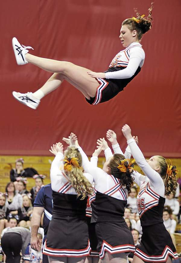 Members of the Machias Memorial High School cheering squad catch a teammate after launching her upward during their routine in the Maine High School Class D Cheerleading Competition at the Bangor Auditorium Saturday afternoon, Feb. 12, 2011.