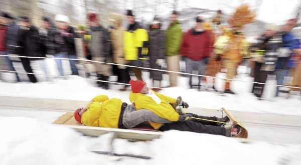 Andy Hazen (right) and Jim Tyler of Lincolnville-based team Beer Coaster slide down the chute during the final runs of the 2011 U.S. National Toboggan Championship at Camden Snow Bowl on Sunday. Hazen has been participating for 18 years and Tyler for 15 years of the 21-year tradition of the competition.