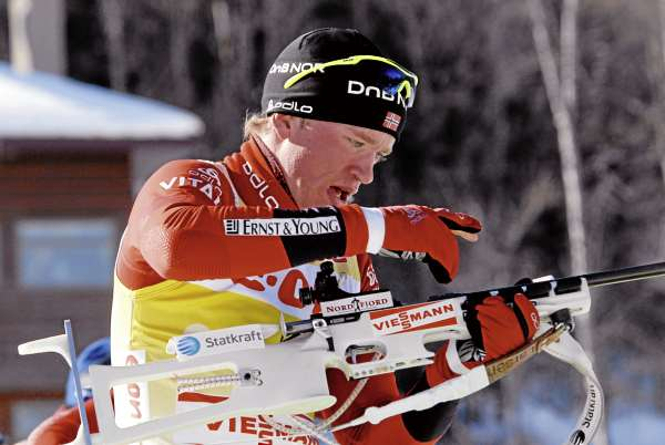Norwegian Tarjei Boe prepares for his first round of firing during the men's pursuit Sunday, Feb. 13, 2011 at the World Cup Biathlon in Fort Kent. Boe finished the 15-kilometer race in third place but earned enough world cup points to retain the gold bib.
