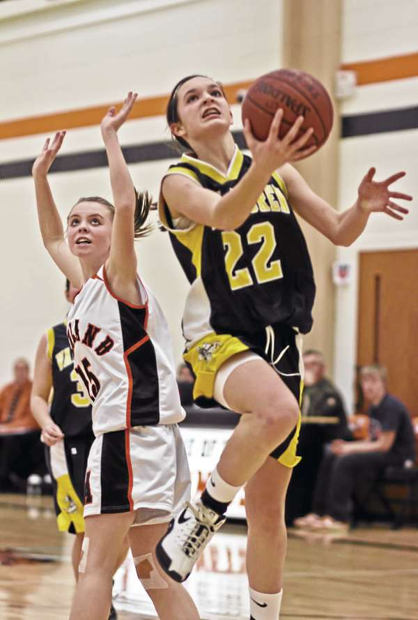 Van Buren's Parise Rossignol drives by Ashland's Kayla Cote during a game on Jan. 19. Rossignol, who is averaging more than 20 points and six assists per game, has led her team to an Eastern Maine Class D prelim berth against Shead in Eastport Tuesday at 5:30 p.m.