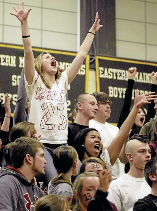 Nokomis cheerleader Cassidy Foster celebrates with Warrior fans as their team makes another basket against Mount Desert Island on Wednesday night during their Eastern Maine Class B preliminary round game in Bar Harbor. Nokomis of Newport upended MDI 56-51.