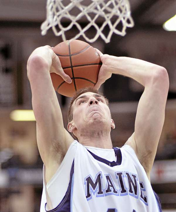Maine's Mike Allison prepares to dunk the ball during the first half of Wednesday night's men's basketball game against Vermont at Alfond Arena in Orono. Vermont won 73-57.