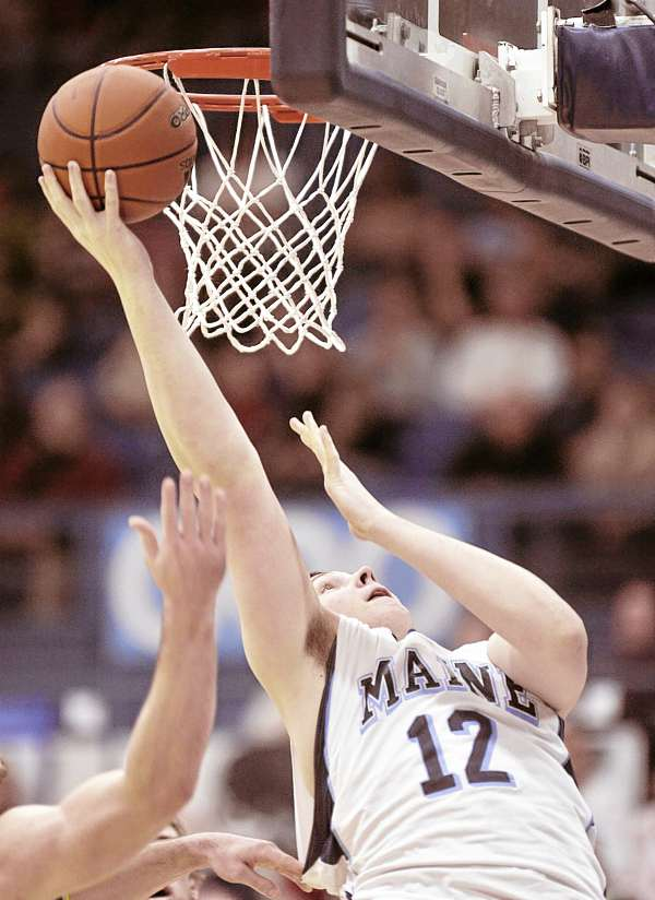 Alasdair Fraser of the University of Maine puts up a shot against Vermont during Wednesday night's men's basketball game at Alfond Arena in Orono. Vermont won 73-57.
