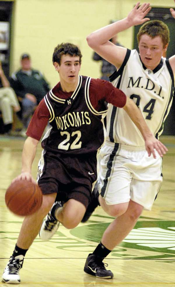 Ethan Pearl (left) of Nokomis of Newport as MDI's Ben Walls trails the play during the first half of Wednesday night's Eastern Maine Class B prelim game in Bar Harbor. Nokomis won 56-51.
