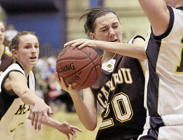 Caribou's Rebecca MacDougal (20) gets caught in between Medomak's Ericka Christensen, right, and Mallory Conary , left, in the second half of their game at the Bangor Auditorium Friday, Feb. 18, 2011. Medomak won 52-30.