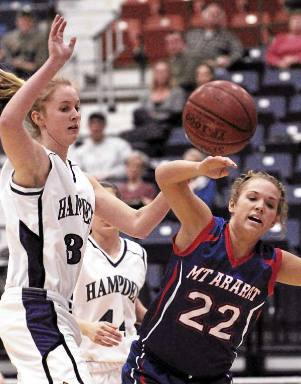 Hampden's Kate Parsons and Mt Ararat'sAmber Bowley collide while rebounding during first period action at the Augusta Civic Center on Friday, February, 18, 2011.