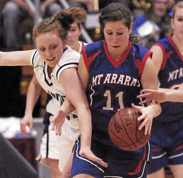 Hampden's Courtney Doyon fouls Mount Ararat's Mariah Copley during a scramble for a loose ball during the third quarter at the Augusta CIvic Center on Friday, February, 18, 2011. Hampden won 47-27.