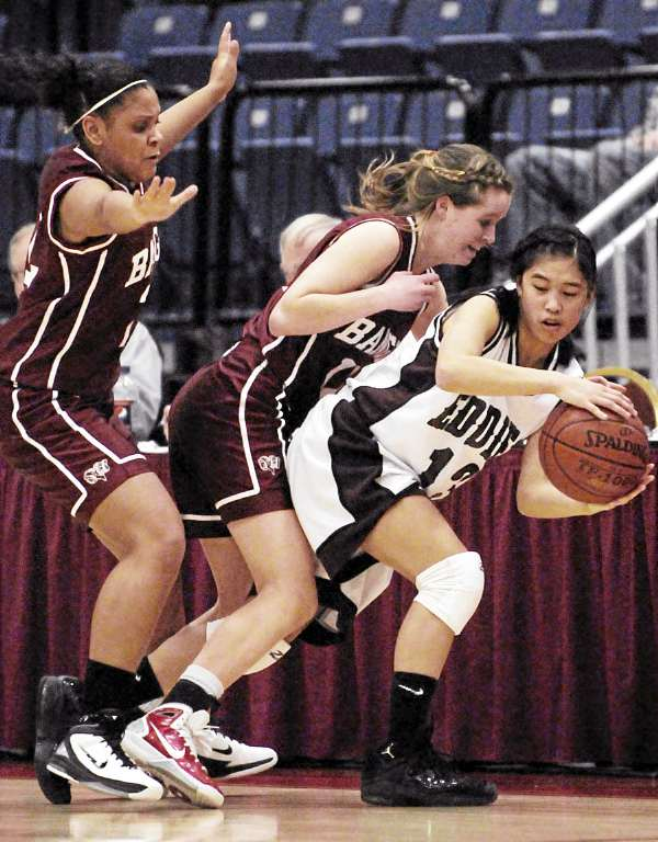 Bangor's Deidre Johnson, left, and Caroline Hetterman crowd Edward Little's Kathrine Sawyer out of bounds as the fourth quarter winds down at the Augusta Civic Center on Friday, February 18, 2011. Edward Little won 74-56.
