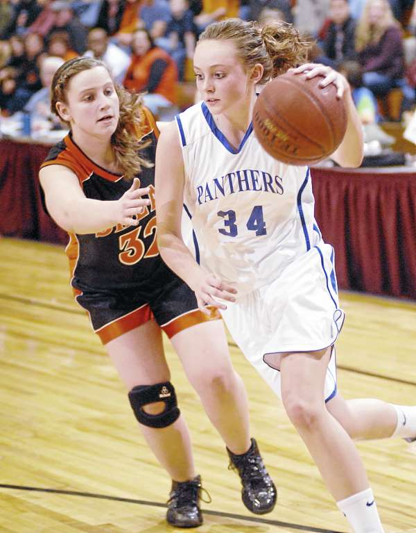 Central Aroostook's Victoria McIntyre looks for an opening around Shead's Sarah Hoche during first-half action at the Bangor Auditorium Saturday night.