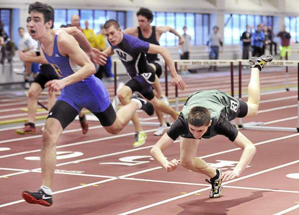 Jake Leithiser (right) of Old Town falls as he crosses the finish line during the 55-meter hurdles final of the state Class B track and field championships Monday at Bates College in Lewiston. Leithiser finished second in the with the time of 8.01 seconds.  Reid Pryzant of Falmouth (left) won with a time of 7.96 seconds, with Leitheiser second at 8.01. The Falmouth boys and Waterville girls won the team titles.