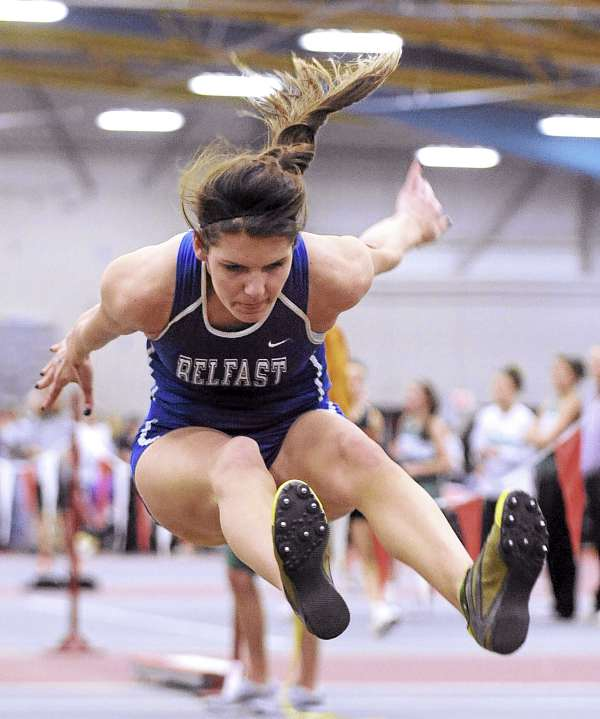 Hannah Hill of Belfast High School competes in the girls triple jump Monday during the Class B state track and field championships at Bates College in Lewiston. Hill won with a jump of 35 feet 8.75 inches.