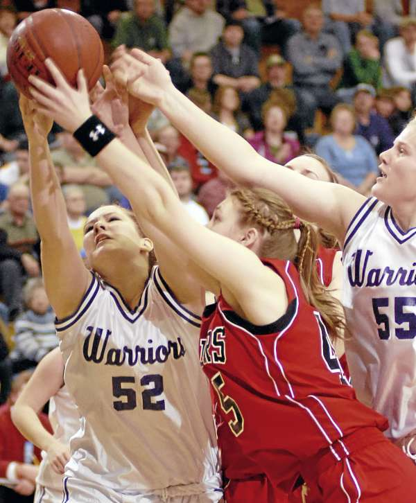 Southern Aroostook's Sable Altvater (52), Fort Fairfield's Amanda Hatham, and Southern Aroostook's Shelby Hartin (55) battle for a rebound in first half action of the girls  Class D quarterfinal game at the Bangor Auditorium on Monday February 21, 2011.