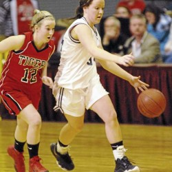 Intense defense carries Washburn girls to EM final