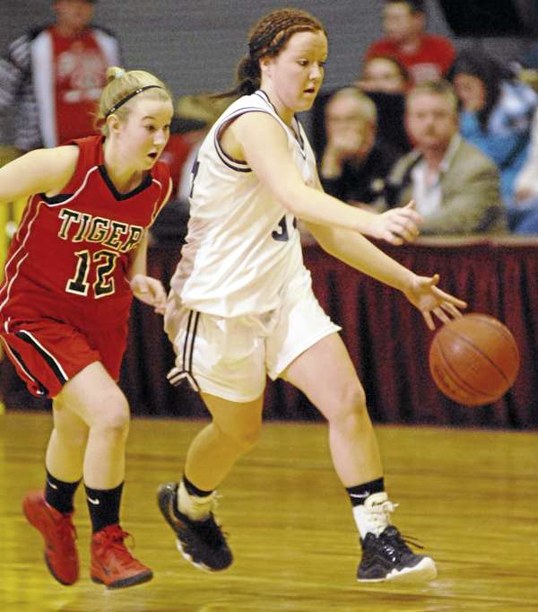 Southern Aroostook's Jasmine Rockwell drives the ball down court by Fort Fairfield defender Logan Bubar in first-half action of the girls Class D quarterfinal game at the Bangor Auditorium on Monday February 21, 2011.