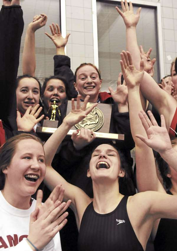Members of the Bangor girls swim team celebrate their team vicory at the Maine High School Girls Class A Swimming and Diving Championship on Monday, February 21, 2011 at Bowdoin College in Brunswick.