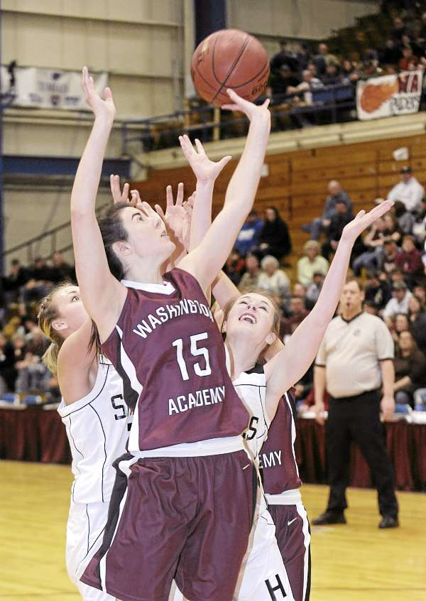 Washington Academy's Jessa Cushing (15) and Houlton High School's Makala Folsom (right) battle for a rebound during the first half of their Eastern Maine Class C girls basketball quarterfinal game at the Bangor Auditorium Tuesday. Washington Academy of East Machias won 43-37.