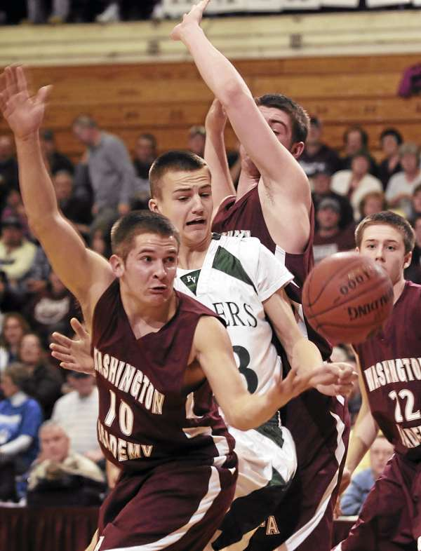 Logan Jipson (center) of Penobscot Valley of Howland loses control of the ball while surrounded by Washington Academy defenders, including Romayn Richards (10), Aaron Huffman and Alex Currier (22) during Eastern Maine Class C boys basketball quarterfinal action Tuesday at the Bangor Auditorium. Penobscot Valley won 58-42.