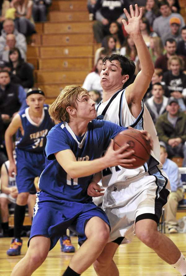 Sumner guard Gabe O'Brien charges the basket against Calais defender Joseph Mitchell on Tuesday during an Eastern Maine Class C boys basketball quarterfinal at the Bangor Auditorium. Sumner won 64-57.
