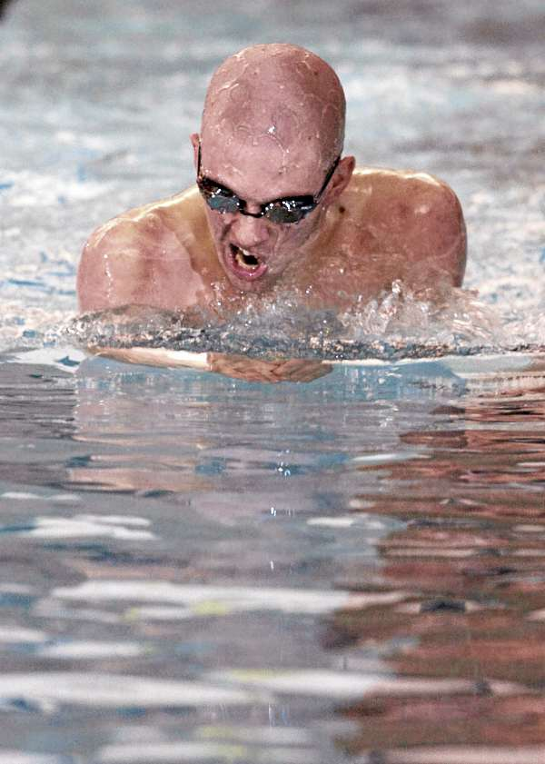 Bangor High School senior Isaac Walton finishes 9th in the 200-yard individual medley during the Class A State meet Tuesday at Bowdoin College. Bangor won the state crown.