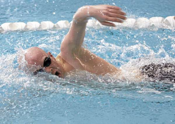 Bangor High School junior Jeff Rogers finishes 5th in the 200-yard freestyle during the Class A state meet Tuesday at Bowdoin College. Bangor won the state title.