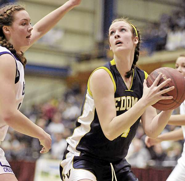 John Bapst's Abby Pyne (44) tries to get a hand in the face of Medomak's Ericka Christensen (14) in the second half of their game Wednesday Feb. 22, 2011 in Bangor.