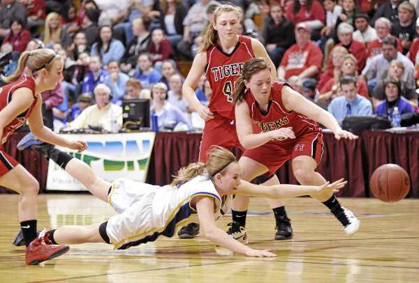 Washburn's Rebecca Campbell, bottom,  dives for a loose ball with Fort Fairfield's Danielle Tracy (25, right), Amanda Hotham and other Tigers nearby in the first quarter of their Class D East girls semifinal at Bangor Auditorium Thursday afternoon.