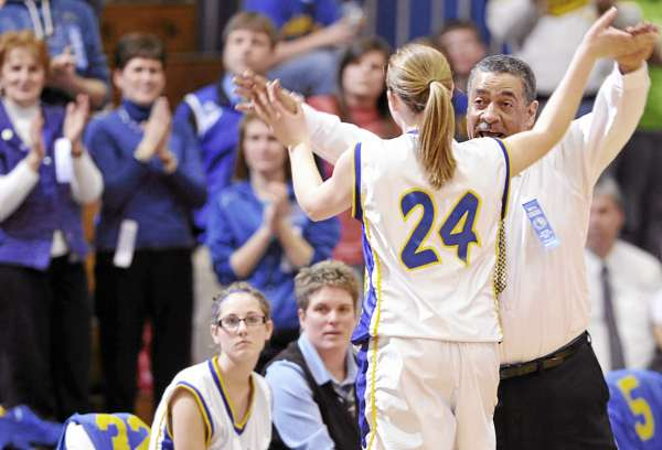Washburn coach Michael Carlos high fives Rebecca Campbell (24) in the closing seconds of their win in their Class D East girls semifinal against Fort Fairfield at Bangor Auditorium Thursday afternoon, Feb. 24, 2011.