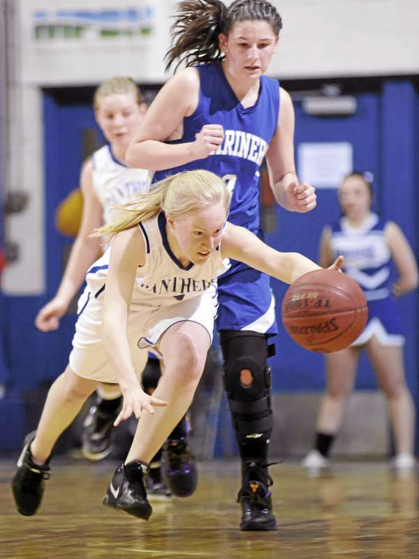 Deer Isle-Stonington's Janelle Ciomei lunges for the ball with Central Aroostook's Sarah Brewer on her heels during their Class D East girls semifinal at Bangor Auditorium Thursday afternoon, Feb. 24, 2011.