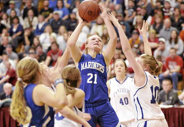 Deer Isle-Stonington's Britnie Jones grabs a rebound in the fourth quarter as Central Aroostook's Kayla Cushman (10, right) and others surround her during the fourth quarter of their Class D East girls semifinal at Bangor Auditorium Thursday afternoon, Feb. 24, 2011.