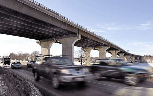 Traffic on South Main St. in Brewer passes under the  Veterans Remembrance Bridge. The bridge spans the Penobscot River and connects the Brewer and Bangor sections of Interstate 395. A $ 2.4 million project to repair the bridge is set to begin next week and could cause traffic delays into the summer.