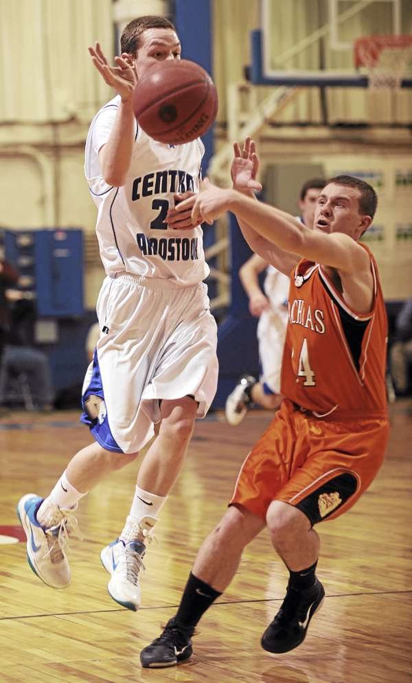 Machias guard Jacob Scoville makes an attempt at stealing a pass from Central Aroostook's Caleb Kelly during second half action on Thursday, February 24, 2011 at the Bangor Auditorium.
