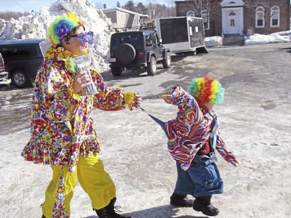 Children of all ages enjoyed the clown school held Thursday at the Family Fun Day in Greenville. The clowns paraded around the Katahdin parking lot. When Danny Mann, 5, of Dover-Foxcroft, popped his suspender button, clown instructor Pat Huckins of Greenville came to his rescue.
