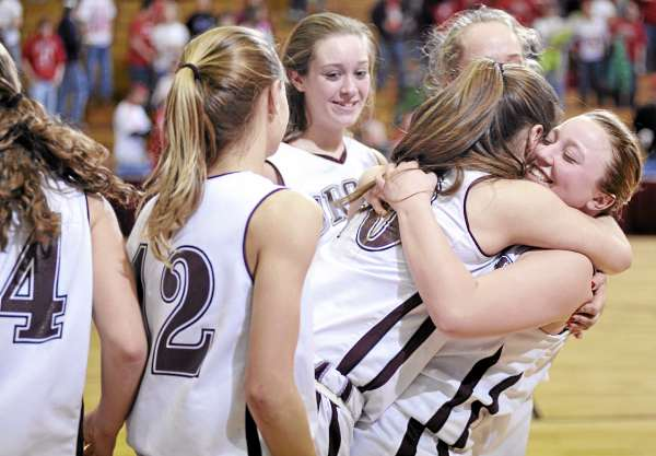 Jade Keezer, far right gives Orono teammate Caleigh Paul a big hug as they celebrate with teammates following their Class C East girls semifinal victory over Dexter at Bangor Auditorium Friday afternoon, Feb. 25, 2011.