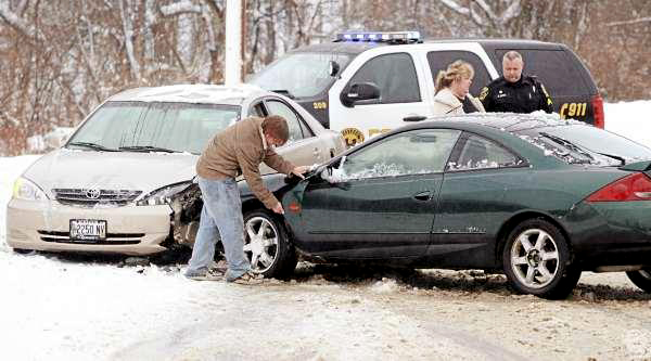 Slushy, icy roads were cited as the cause of a head-on crash Monday afternoon on Mill Street in Brewer in which two Brewer residents escaped serious injury. Brewer police Cpl. Steve Boyd, right, said the accident occurred shortly before 3 p.m. and resulted in significant damage to a 2003 Toyota Camry driven by Donna Buckley, 47, center, and a 1999 Mercury Cougar driven by 18-year-old Alex Lawrence, left. Boyd said neither motorist required a trip to the hospital.