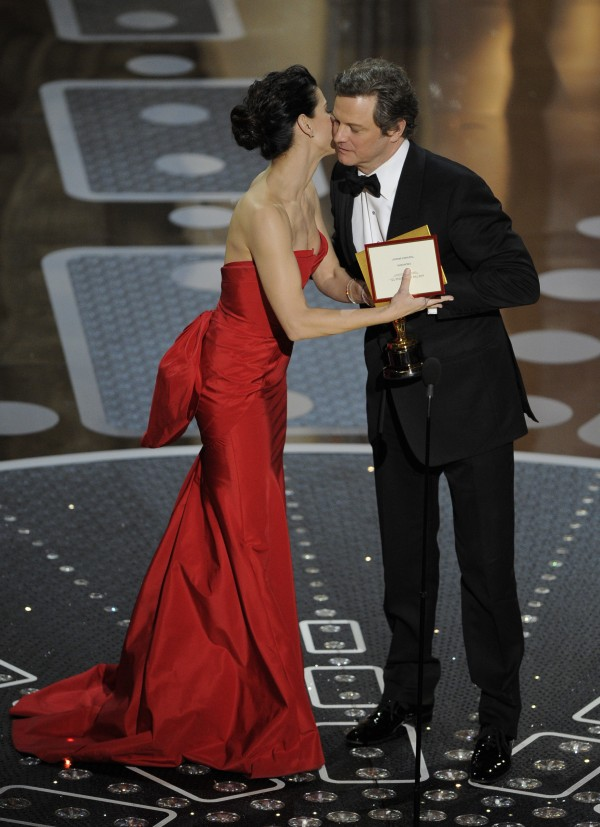 Sandra Bullock congratulates Colin Firth as he accepts the Oscar for best performance by an actor in a leading role for &quotThe King's Speech&quot at the 83rd Academy Awards on Sunday, Feb. 27, 2011, in Hollywood.