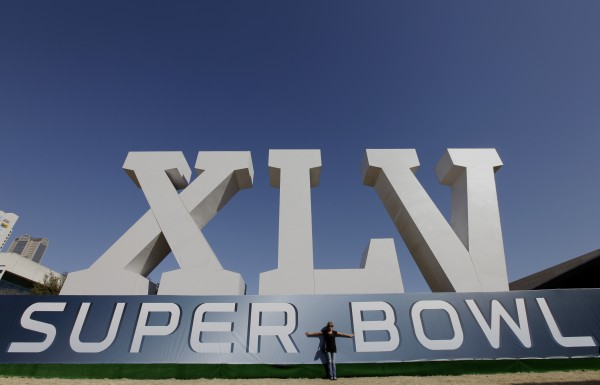 Becky Aduddell of The Colony, Texas, poses for a picture outside the NFL Experience on Saturday in Dallas.
