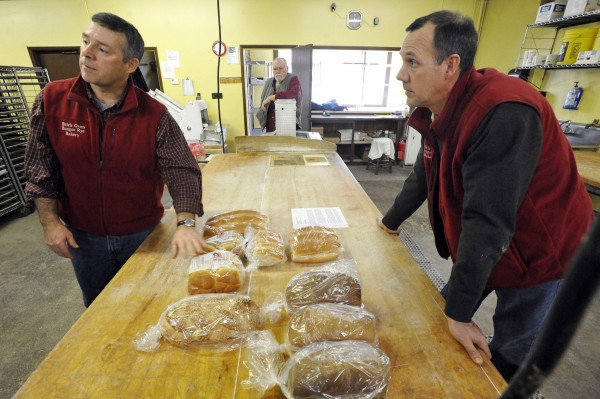 Brothers Paul Huston, left, and Peter Huston, right, have purchased The Brick Oven Bangor Rye Bakery from Ralph Beckwith (center.)