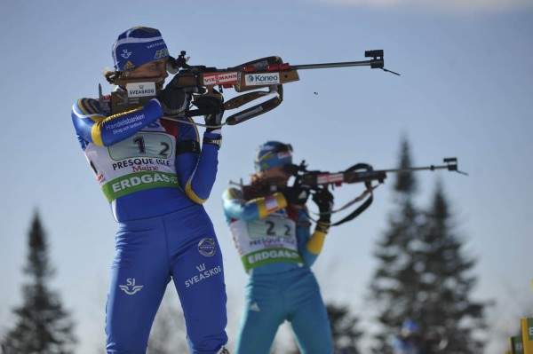 Second leg competitors Anna-Karin Stroemstedt, left, of Sweden and Inna Suprun of the Ukraine practice at the target range before the start of the I.B.U. World Cup mixed relay biathlon at the Nordic Heritage Center in Presque Isle, Maine Saturday afternoon, Feb. 5, 2011.